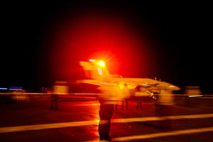 An F/A-18E Super Hornet aircraft launches from the flight deck the Nimitz-class aircraft carrier USS Abraham Lincoln in the  Persian Gulf.