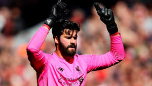 LIVERPOOL, ENGLAND - MAY 12: Alisson of Liverpool celebrates his sides second goal during the Premier League match between Liverpool FC and Wolverhampton Wanderers at Anfield on May 12, 2019 in Liverpool, United Kingdom. (Photo by Chris Brunskill/Fantasista/Getty Images)