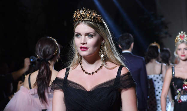 Kitty Spencer walks the runway at the Dolce & Gabbana secret show during Milan Fashion Week Spring/Summer 2018 at Bar Martini on September 23, 2017 in Milan, Italy.