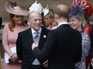 Britain's Prince Philip, Duke of Edinburgh (L) chats to Britain's Prince Harry, Duke of Sussex on the steps of St George's Chapel in Windsor Castle, Windsor, west of London, on May 18, 2019, after the wedding ceremony of Lady Gabriella Windsor and Thomas Kingston. - Lady Gabriella, is the daughter of Prince and Princess Michael of Kent. Prince Michael, is the Queen Elizabeth II's cousin. (Photo by Steve Parsons / POOL / AFP)        (Photo credit should read STEVE PARSONS/AFP/Getty Images)