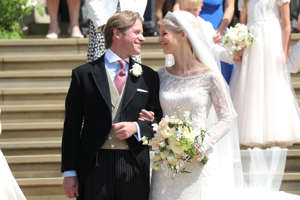 Newlyweds Thomas Kingston and Lady Gabriella Windsor smile on the steps of the chapel after their wedding at St George's Chapel in Windsor Castle, near London, Britain May 18, 2019. Chris Jackson/Pool via REUTERS