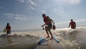 Adaptive surfing program gives people with disabilities a day on the water