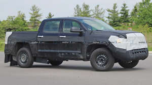 a truck that is driving down the road: Toyota Tundra Hybrid Spy Shots