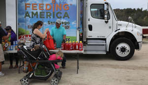 Residents receive free food at mobile food pantry