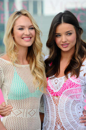 BEVERLY HILLS, CA - MARCH 29:  Victoria's Secret Angels Candice Swanepoel and Miranda Kerr launch the 2012 Swim Collection at the Thompson Hotel on March 29, 2012 in Beverly Hills, California.  (Photo by Alberto E. Rodriguez/Getty Images)