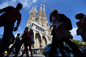 People stand outside the Sagrada Familia cathedral in Barcelona, Spain, October 11, 2017. REUTERS/Ivan Alvarado