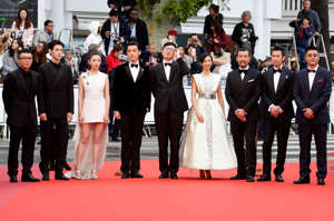 "72nd Cannes Film Festival - Screening of the film ""The Wild Goose Lake"" (Nan Fang Che Zhan De Ju Hui) in competition - Red Carpet Arrivals - Cannes, France, May 18, 2019. Director Diao Yinan, cast members Liao Fan, Hu Ge, Gwei Lun-Mei, Wan Qian, Zhang Yicong, Qi Dao and producer Li Li pose. REUTERS/Eric Gaillard"