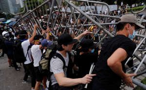 Demonstrators attempt to move metal barricades during a protest against a proposed extradition bill in Hong Kong in Hong Kong, China June 12, 2019.