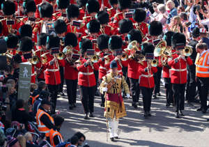 WINDSOR, UNITED KINGDOM - MAY 19: Irish Guards marching band parades through Windsor for the wedding of Prince Harry and Meghan Markle at Windsor Castle on May 19, 2018 in Windsor, England. (Photo by Andrew Matthews - WPA Pool/Getty Images)