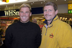 Australian cricketer Shane Warne arrives at Heathrow Airport, where he is greeted by Hampshire captain Robin Smith. The spin-bowler will attend a press conference at Hampshire County Cricket club in Southampton marking his arrival at the club.   (Photo by Tim Ockenden - PA Images/PA Images via Getty Images)