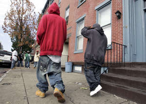 Two young men with low-slung, baggy jeans walk in Trenton, N.J., Saturday, Sept. 15, 2007. Wearing your pants low enough to show your boxers or bare buttocks in a small town in Louisiana could get you six months in jail and a $500 fine and Trenton is considering a law, where a first bust for low-riding trousers could soon mean an assessment by a city worker on where your life is going.