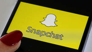 PARIS, FRANCE - APRIL 05: In this photo iIllustration, the Snapchat social media logo is displayed on the screen of an iPhone on April 05, 2019 in Paris, France. During its 'Partner Summit 2019' in Santa Monica, Snapchat has announced several new features to come. Most notable is the ability to send stories to the Tinder dating app. Snapchat is a free photo and video sharing application which has 13 million daily users worldwide. (Photo by Chesnot/Getty Images)