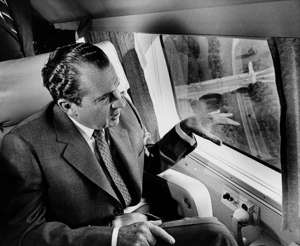 President Nixon makes a first-hand survey of transportation arteries into Washington, D.C., during a morning helicopter flight, June 24, 1969. Visible through the helicopter window is part of the Memorial Bridge. Running beneath the bridge is the George Washington Memorial Parkway. (AP Photo/Pool)