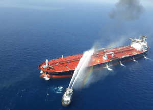 A picture obtained by AFP from Iranian news agency Tasnim on June 13, 2019, reportedly shows an Iranian navy boat trying to control fire from Norwegian owned Front Altair tanker said to have been attacked in the waters of the Gulf of Oman.