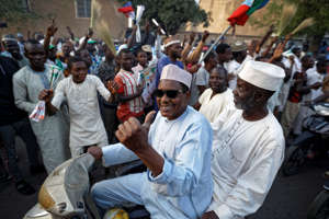 File Photo-Supporters of President Muhammadu Buhari celebrate the announcement of results favoring his All Progressives Congress (APC) party in their state, anticipating victory, in Kano