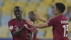 Qatar's Almoez Ali (L) celebrates with teammate Bassam Al-Rawi after scoring against Paraguay during their Copa America football tournament group match at Maracana Stadium in Rio de Janeiro, Brazil, on June 16, 2019. (Photo by Pedro UGARTE / AFP)        (Photo credit should read PEDRO UGARTE/AFP/Getty Images)