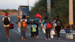 Venezuelan migrants walk on the Pan-American Highway, after crossing the border Peru - Ecuador after stricter entry requirements went into effect, in Tumbes, Peru, Saturday, June 15, 2019. With its relatively stable economy and flexible immigration laws, Peru has become a main destination for millions of Venezuelans escaping hyperinflation, medical shortages and political repression at home. (AP Photo/Martin Mejia)