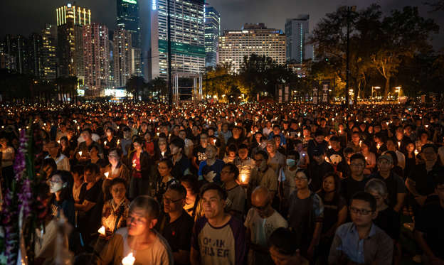 Slide 1 de 31: HONG KONG, HONG KONG - JUNE 04: People hold candles as they take part in a candlelight vigil at Victoria Park on June 4, 2019 in Hong Kong, China. As many as 180,000 people are expected to attend a candlelight vigil in Hong Kong on Tuesday during the 30th anniversary of the Tiananmen Square massacre as commemorations took place in cities around the world on June 4 to remember those who died when Chinese troops cracked down on pro-democracy protesters. Thirty years ago, the People's Liberation Army opened fire and killed from hundreds to thousands of protesters in Beijing after hundreds of thousands of students and workers gathered in Tiananmen Square for weeks to call for greater political freedom. No-one knows for sure how many people were killed as China continues to censor any coverage or discussion of the event that takes place during the anniversary.  (Photo by Anthony Kwan/Getty Images)
