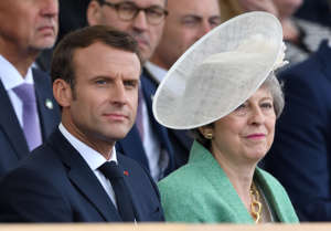 PORTSMOUTH, ENGLAND - JUNE 05: French President Emmanuel Macron and Britain's Prime Minster Theresa May attend the D-Day75 National Commemorative Event to mark the 75th Anniversary of the D-Day Landings at Southsea Common on June 05, 2019 in Portsmouth, England. (Photo by Karwai Tang/WireImage)