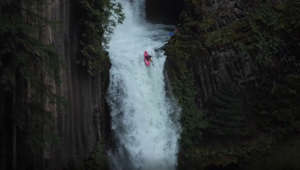 Man survives kayak plunge down massive waterfall