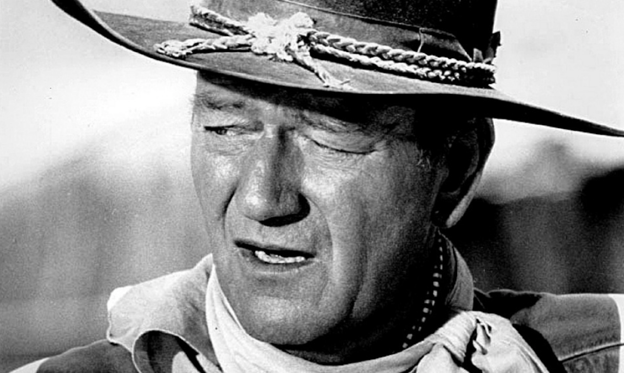 "Slide 1 of 101: Before he was one of Hollywood's most bankable and iconic Western movie stars, actor John Wayne was a USC lineman named Marion Morrison. After injuring his shoulder in a body-surfing accident, Morrison lost his football scholarship and landed a job in 1927 as a prop guy on the Fox studios lot. That gig didn't last long, however, as it took just three years for Morrison to snag his first lead role in 1930's ""The Big Trail."" Not being fond of the name Marion Morrison, the movie's producers instructed director Raoul Walsh to change it. John Wayne was thus born.  John Wayne's unabashedly masculine personality might seem a little antiquated these days, but his substantial portfolio nevertheless persists as the stuff of legend. Wayne was credited in at least 177 movies over the course of his career. That's not to mention his oft-overlooked (and frequently uncredited) credits as a producer and director. Suffice to say, the man kept a formidable work ethic from one decade to the next that resulted in not just some of Hollywood's most classic Westerns, but some of its best films, period.  In honor of The Duke himself, Stacker is ranking John Wayne's best 100 movies. Going from lowest to highest, we ranked each movie according to its IMDb rating, focusing only on Wayne's acting credits. It's worth noting that most of Wayne's films don't have too many user votes, but that's largely because they were released in the first half of the 1900s. Without further ado, we present John Wayne's best 100 films. Take 'er easy there, pilgrim!  You may also like: Best black and white films of all time"