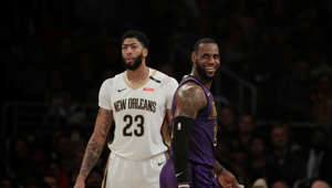 Los Angeles Lakers' LeBron James, right, smiles as he walks past New Orleans Pelicans' Anthony Davis during the first half of an NBA basketball game, Friday, Dec. 21, 2018, in Los Angeles. (AP Photo/Jae C. Hong)