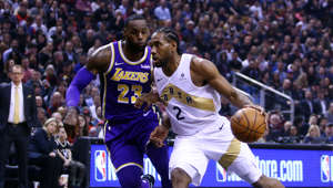 TORONTO, ON - MARCH 14:  Kawhi Leonard #2 of the Toronto Raptors dribbles the ball as LeBron James #23 of the Los Angeles Lakers defends during the first half of an NBA game at Scotiabank Arena on March 14, 2019 in Toronto, Canada.  NOTE TO USER: User expressly acknowledges and agrees that, by downloading and or using this photograph, User is consenting to the terms and conditions of the Getty Images License Agreement.  (Photo by Vaughn Ridley/Getty Images)