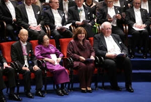 Laureates in the 2015 Nobel Prize in Physiology or Medicine (Front, L to R), Japanese Satoshi Omura and Chinese Youyou Tu, Nobel Literature prize 2015 laureate Belarus Svetlana Alexievitch and Nobel Economics Prize 2015 laureate US-British Angus Deaton attend the 2015 Nobel prize award ceremony at the Stockholm Concert Hall on December 10, 2015. The Prize ceremony for the 2015 literature, medicine, chemistry, physics and economics Nobel laureates will be followed by the traditional banquet at the Stockholm city hall.  AFP PHOTO / SOREN ANDERSSON / AFP / SOREN ANDERSSON        (Photo credit should read SOREN ANDERSSON/AFP/Getty Images)