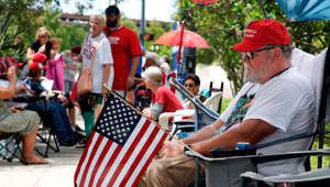 Supporters of US President Donald Trump wait along one of the main streets outside the Amway Center on June 17, 2019 some 40 hours before a Trump campaign event in Orlando, Florida. - President Trump is expected to launch his 2020 re-election campaign here on Tuesday night. (Photo by Gregg Newton / AFP)        (Photo credit should read GREGG NEWTON/AFP/Getty Images)