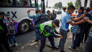 26 May 2019, Mexico, Itzapalapa: Police check bus passengers at a bus stop. They're supposed to prevent armed people from getting on the bus. Since Itzapalapa has seen many thefts in public transport, police officers are now to travel with them. Itzapalapa leads the crime statistics of the Mexican capital. Almost 2,000 thefts are said to have been committed there in April 2019. Photo: Jair Cabrera Torres/dpa (Photo by Jair Cabrera Torres/picture alliance via Getty Images)