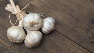 Close-Up Of Garlic On Cutting Board