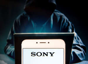 HONG KONG, CHINA - 2018/12/02: Japanese multinational technology conglomerate corporation Sony logo is seen on an Android mobile device with a figure of hacker in the background. (Photo by Miguel Candela/SOPA Images/LightRocket via Getty Images)