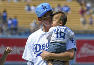 Jun 16, 2019; Los Angeles, CA, USA; Los Angeles Dodgers starting pitcher Kenta Maeda (18) with his son and daughter on Father's Day before the game against the Chicago Cubs at Dodger Stadium.