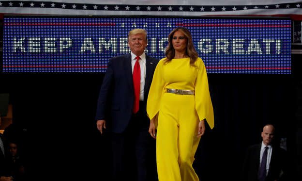 U.S. President Donald Trump and first lady Melania Trump arrive on stage to formally kick off his re-election bid with a campaign rally in Orlando, Florida, U.S., June 18, 2019.  REUTERS/Carlos Barria