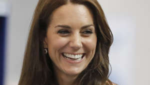 Britain's Kate, Duchess of Cambridge smiles during a visit for the opening of the Centre of Excellence for Hayward Tyler, the worldwide market leader in the manufacture of Boiler Circulating Pumps and specialist wet-wound motors in Luton, England, Wednesday, Aug. 24, 2016. (AP Photo/Frank Augstein, Pool)