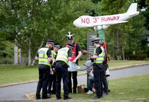 Protestors demonstrating against plans for a third runway at London Heathrow Airport outside the Scottish National Party (SNP) conference at the Aberdeen Exhibition and Conference Centre.