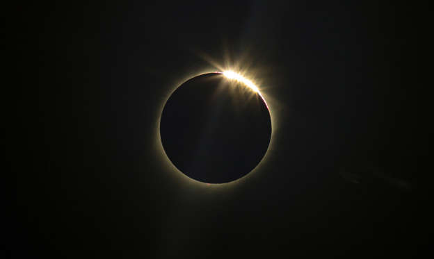 Slide 1 of 30: The moon blocks the sun during a total solar eclipse in La Higuera, Chile, Tuesday, July 2, 2019. Northern Chile is known for clear skies and some of the largest, most powerful telescopes on Earth are being built in the area, turning the South American country into a global astronomy hub. (AP Photo/Esteban Felix)