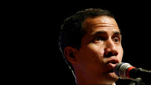 "Venezuela's opposition leader and self-proclaimed interim president Juan Guaidó presents details of his ""Plan Pais"" or Plans for the Country, during a meeting with the agro-food sector, in Caracas, Venezuela, Wednesday, June 19, 2019. (AP Photo/Ariana Cubillos)"