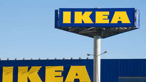 """Ankara, Turkey - June 17, 2012:  IKEA billboard in front of their own appliances retailer. IKEA is an international home products company that designs and sells ready to assemble furniture."""