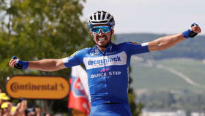 Cycling - Tour de France - The 215-km Stage 3 from Binche to Epernay - July 8, 2019 - Deceuninck-Quick Step rider Julian Alaphilippe of France wins the stage. REUTERS/Gonzalo Fuentes