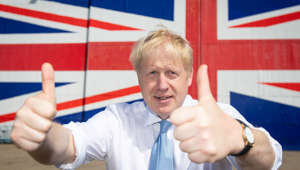 ISLE OF WIGHT, ENGLAND - JUNE 27: Conservative party leadership contender Boris Johnson poses for a photograph in front of a Union Jack on a wall at the Wight Shipyard Company at Venture Quay during a visit to the Isle of Wight on June 27, 2019 in London, England. Boris Johnson and Jeremy Hunt are the remaining candidates in contention for the Conservative Party Leadership and thus Prime Minister of the UK. Results will be announced on July 23rd 2019. (Photo by Dominic Lipinski - WPA Pool/Getty Images)