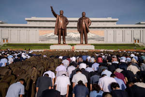 People bow before the statues of the late North Korean leaders Kim Il Sung and Kim Jong Il as the country marks the 25th death anniversary of Kim Il Sung, at Mansu Hill in Pyongyang on July 8, 2019. (Photo by Kim Won Jin / AFP)        (Photo credit should read KIM WON JIN/AFP/Getty Images)