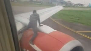 Intruder climbs onto the engine of a plane just before takeoff