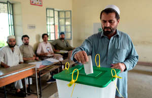 A tribesman ballot casts his vote in a polling station for the first provincial elections in Jamrud, a town of the Khyber Pakhtunkhwa province on July 20, 2019. - Pakistan's tribal areas held their first ever provincial elections on July 20 amid high security, a key step bringing the northwestern region into the political mainstream after years of turmoil fuelled by militancy. (Photo by ABDUL MAJEED / AFP)        (Photo credit should read ABDUL MAJEED/AFP/Getty Images)