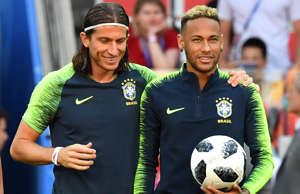 Brazil's forward Neymar (R) and Brazil's defender Filipe Luis take part in a training session with teammates at the Luzhniki stadium in Moscow on June 26, 2018, on the eve of the Russia 2018 World Cup Group E football match between Serbia and Brazil. (Photo by Yuri KADOBNOV / AFP)        (Photo credit should read YURI KADOBNOV/AFP/Getty Images)