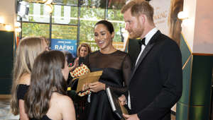 Britain's Meghan, Duchess of Sussex, and Prince Harry, Duke of Sussex, chat with children of Disney executives as they arrive for the European premiere of the film The Lion King in London, Britain July 14, 2019. Niklas Halle'n/Pool via REUTERS
