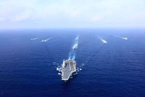 AT SEA - APRIL: A PLA Navy fleet including the aircraft carrier Liaoning, vessels and fighter jets take part in a drill in April 2018 in the South China Sea. (Photo by VCG)
