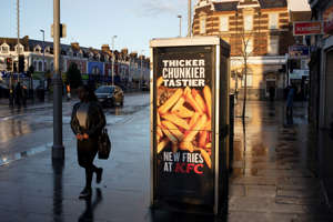 KFC advertising their new type of fries on a wet day in Leytonstone in East London, United Kingdom. Leytonstone is an area of East London, and part of the London Borough of Waltham Forest. (photo by Mike Kemp/In PIctures via Getty Images)
