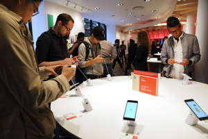 NEW YORK, NY - OCTOBER 19:  People look at Google's new Pixel 2 phones at a New York City pop-up shop on October 19, 2017 in New York City. The temporary store in the Flatiron neighborhood of Manhattan sells and demonstrates such Google products as the new Pixel 2 phone, home speakers, pixel Buds, and the Daydream View VR headset.  (Photo by Spencer Platt/Getty Images)