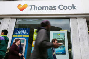 LONDON, UNITED KINGDOM - 2019/05/18: People are seen walking past a Thomas Cook branch in central London.  Holiday group, Thomas Cook risks collapse with thousands of holiday bookings in jeopardy as its shares dropped by more than 40 per cent on Friday after it was announced that the company recorded a £1.5 billion loss for the first half of the year and City analysts branded them as worthless. (Photo by Dinendra Haria/SOPA Images/LightRocket via Getty Images)